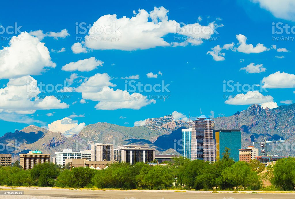 Tucson downtown skyline with mountains and many puffy clouds stock photo