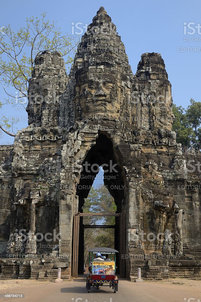 Tuc-tuc entering the gates of Angkor Wat royalty-free stock photo