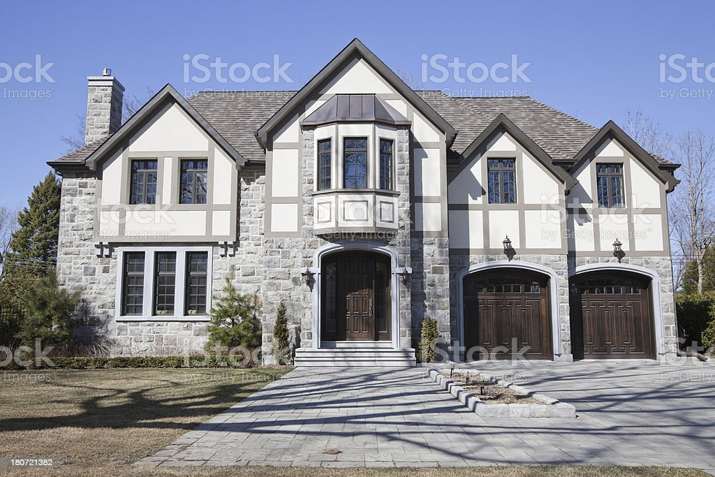 Tudor and fieldstone house in the spring stock photo