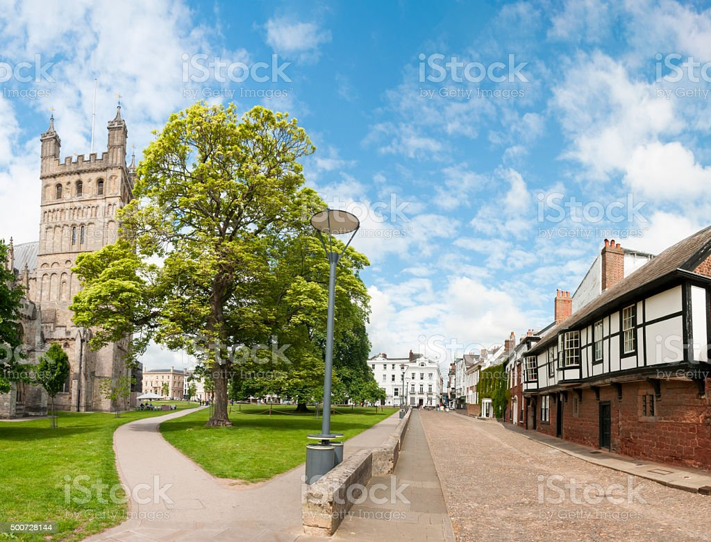 Tudor Buildings And Exeter Cathedral In England stock photo