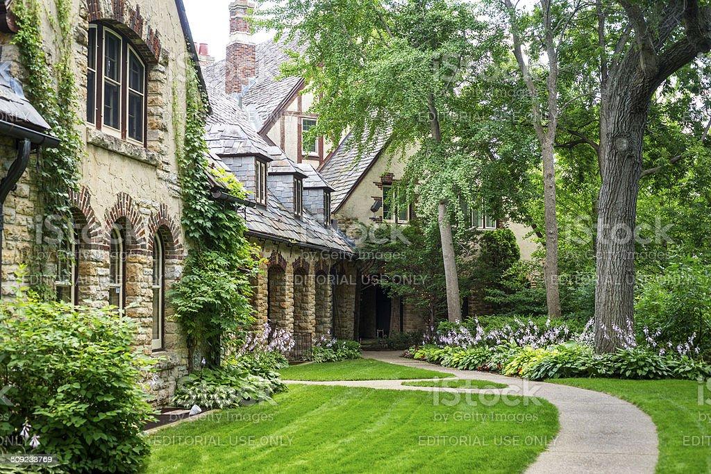 Tudor House and landscaped yard stock photo