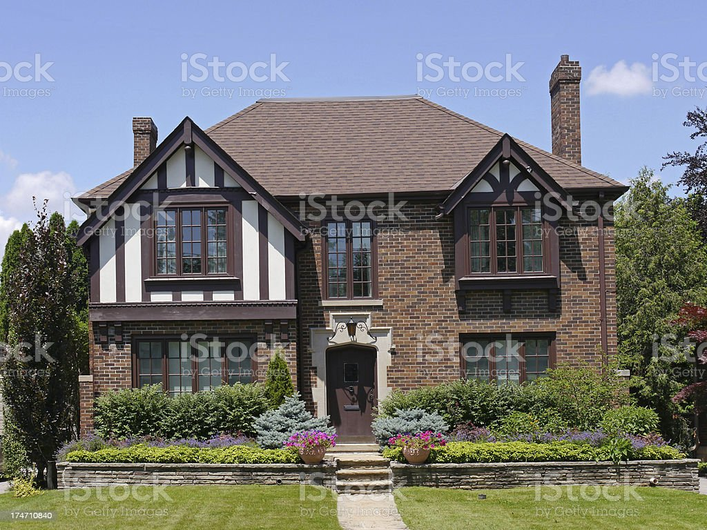 Tudor style brick house stock photo