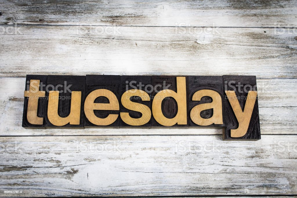 Tuesday Letterpress Word on Wooden Background stock photo