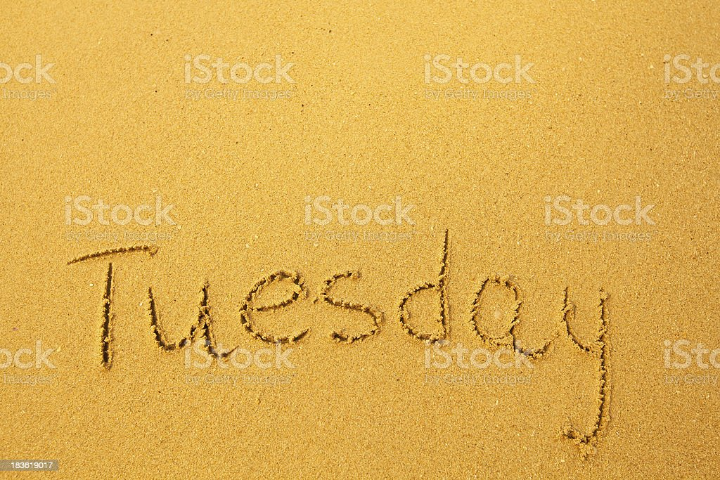 Tuesday - written in sand on beach texture. royalty-free stock photo