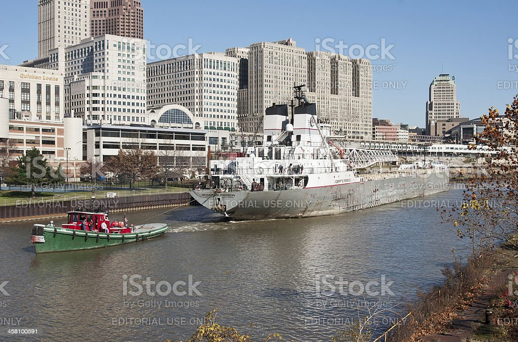 Tug and Freighter stock photo