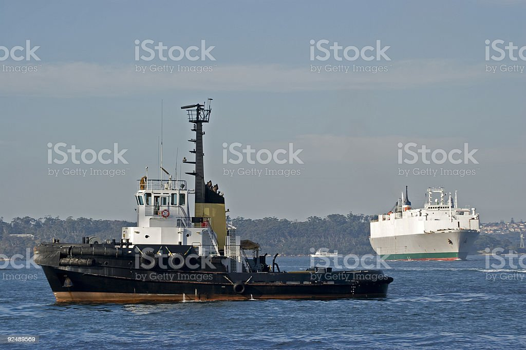 Tug boat and car carrier ship royalty-free stock photo