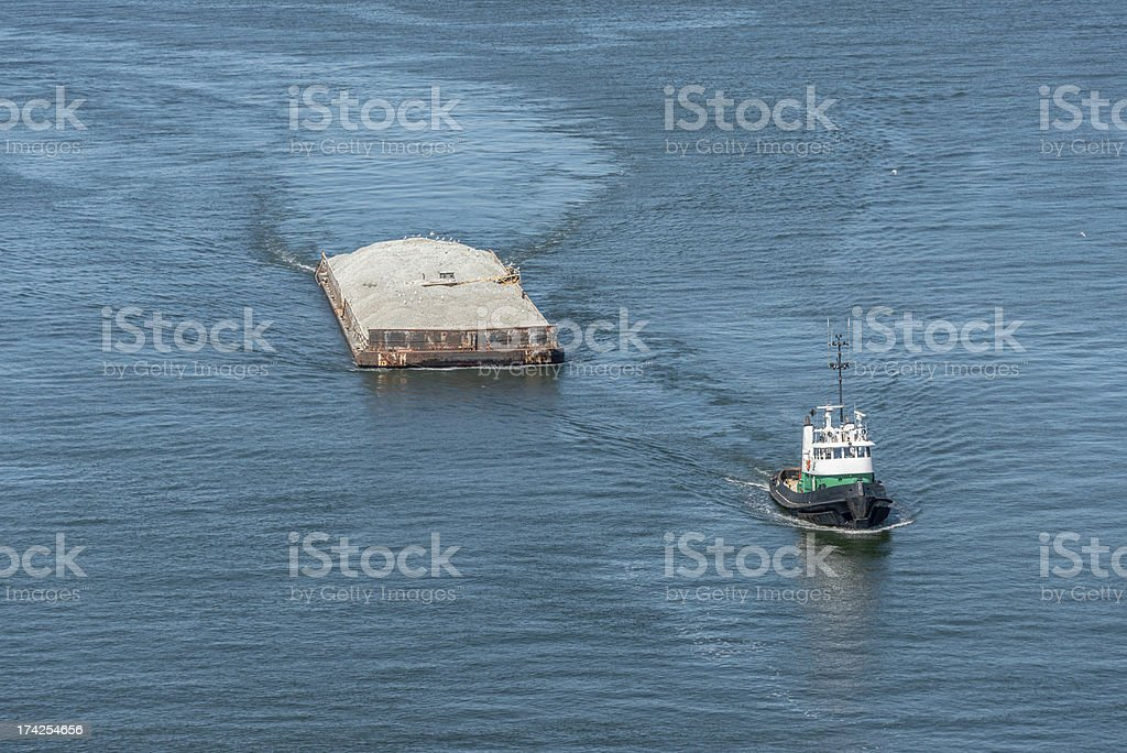 Tug Boat carrying dirt royalty-free stock photo