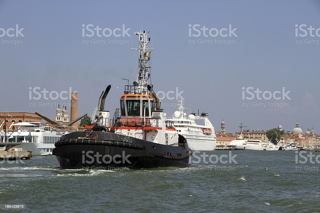 tug boat to bring out from the port royalty-free stock photo