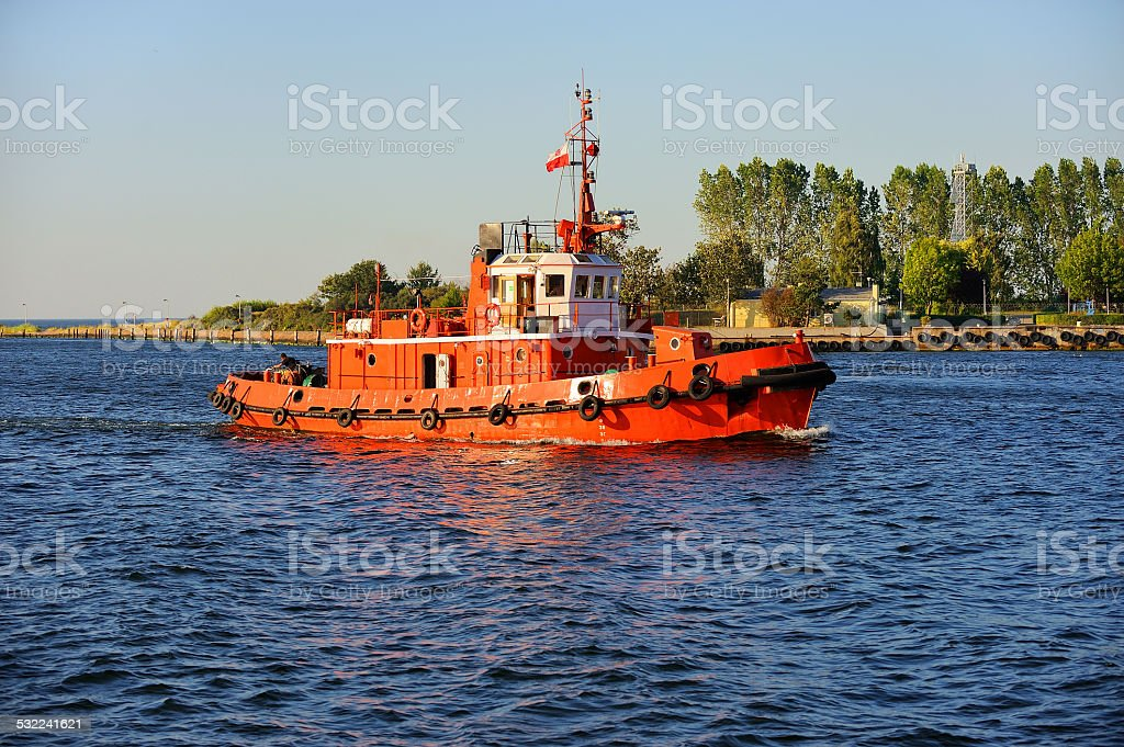 Tug boat working in the port stock photo