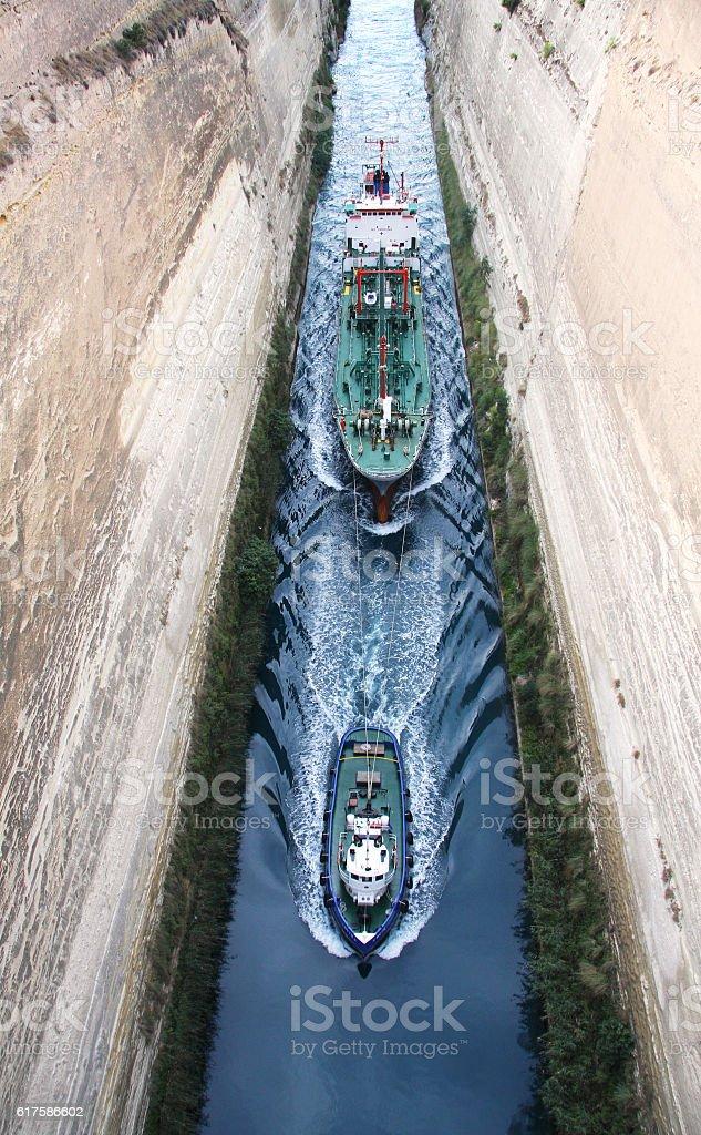 Tug conducting ship through the Corinth canal stock photo