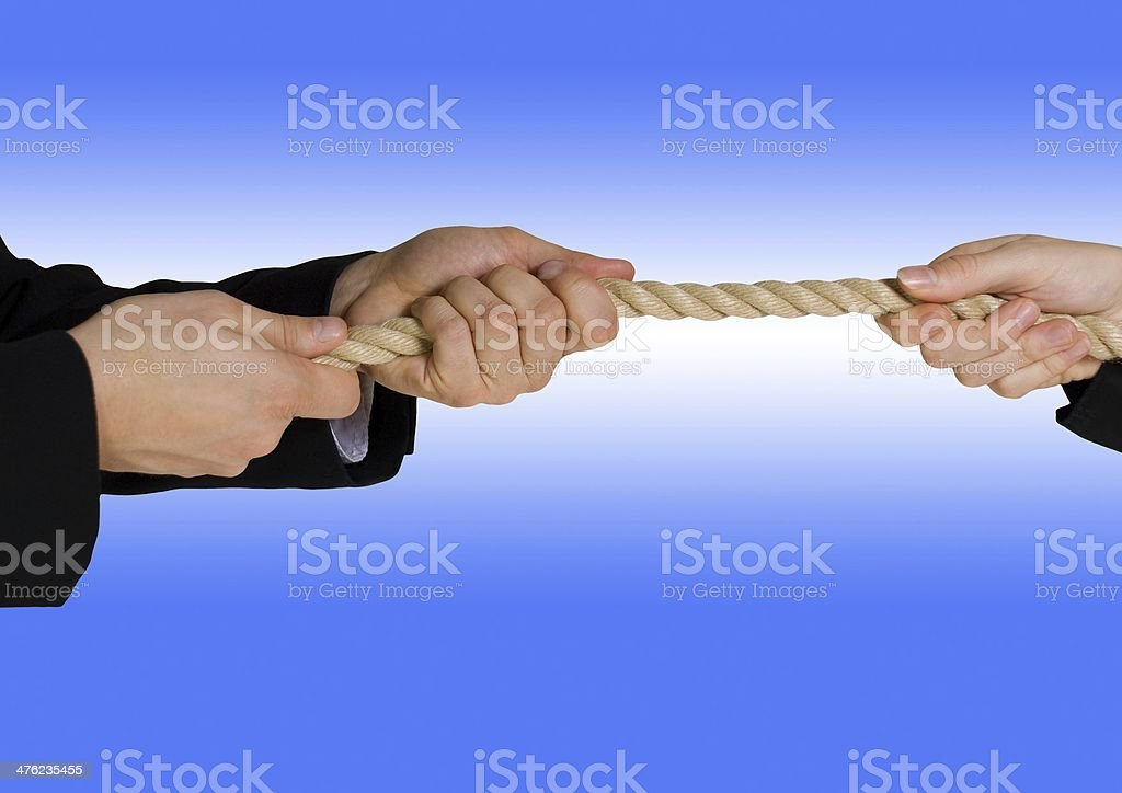 tug of war with blue background royalty-free stock photo