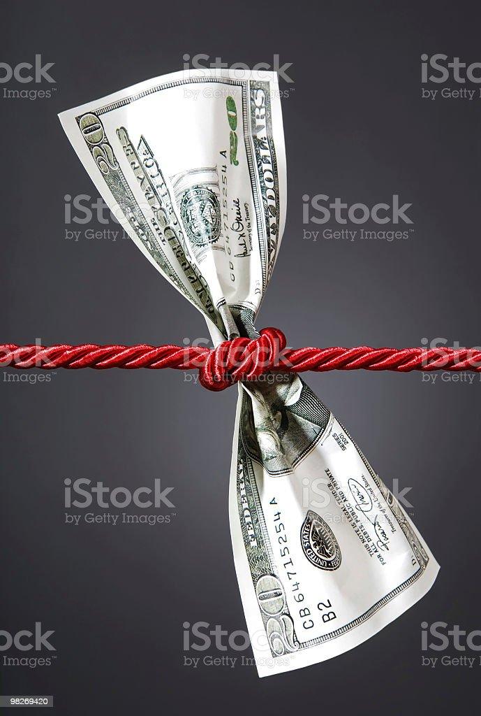 Tug of war with dollar stock photo