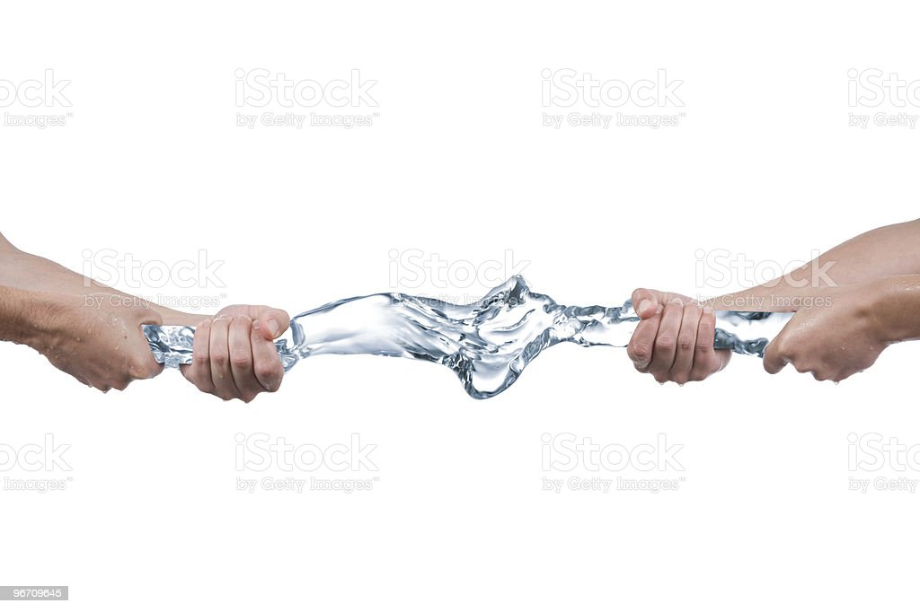 Tug of war with water stock photo