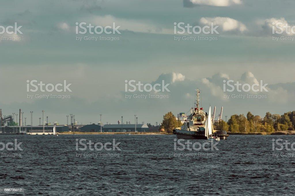 Tug ship and sailboat stock photo
