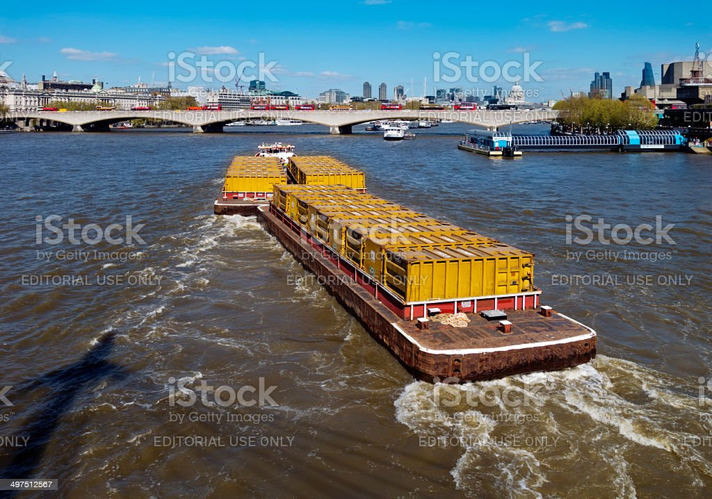 Tug towing barges on the River Thames stock photo