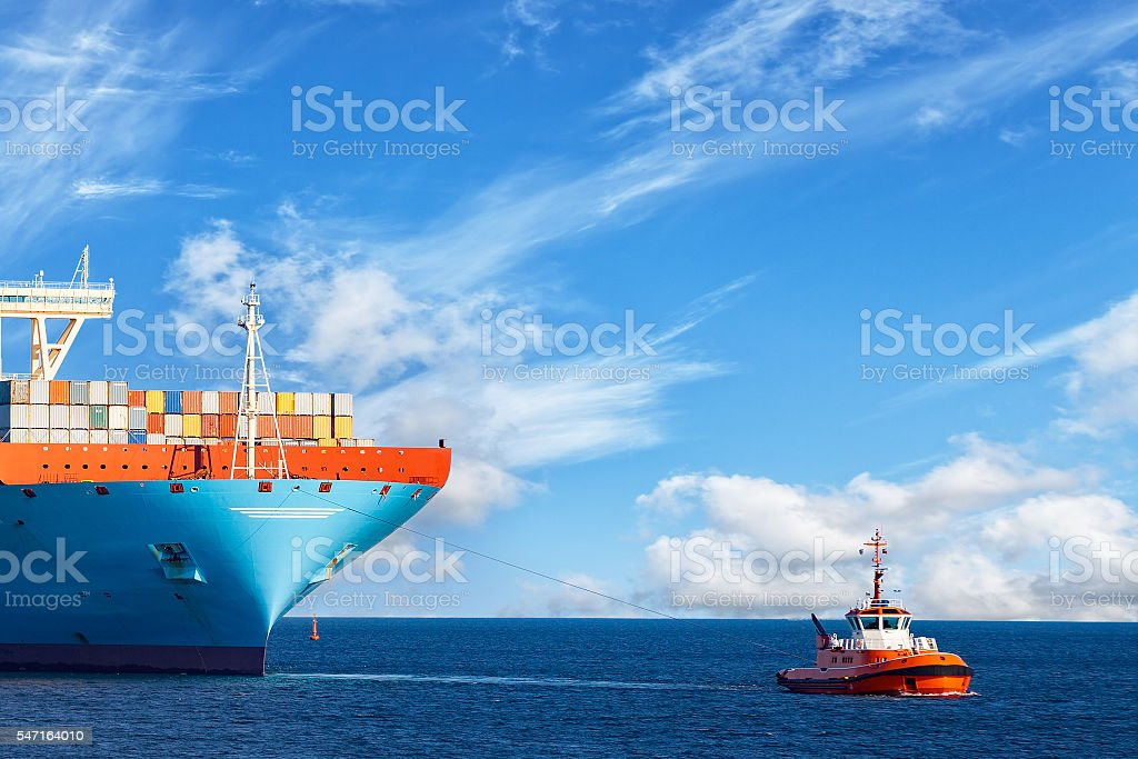 Tug with ship stock photo