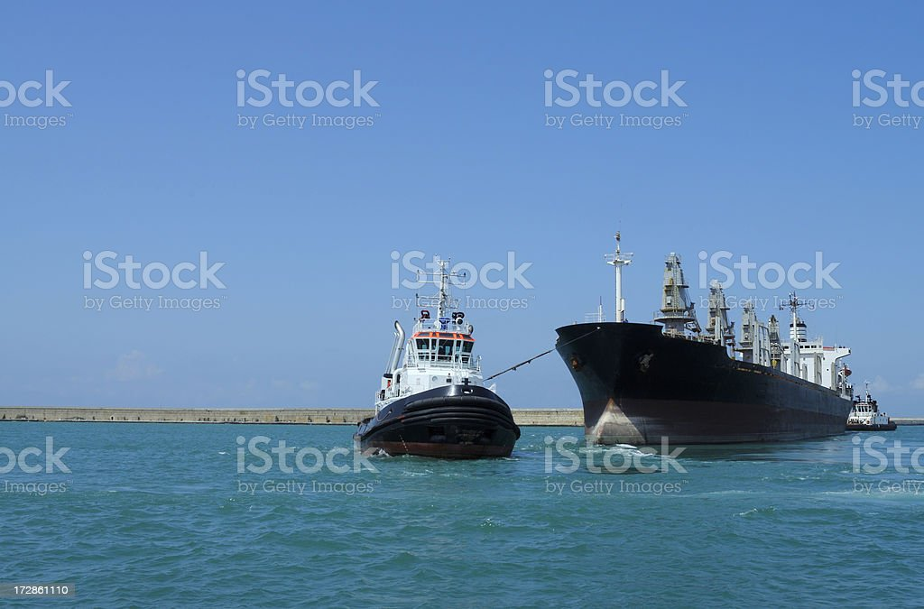 Tugboat and Cargo Container Ship stock photo