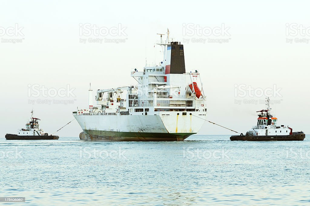 Tugboat and Cargo ship royalty-free stock photo
