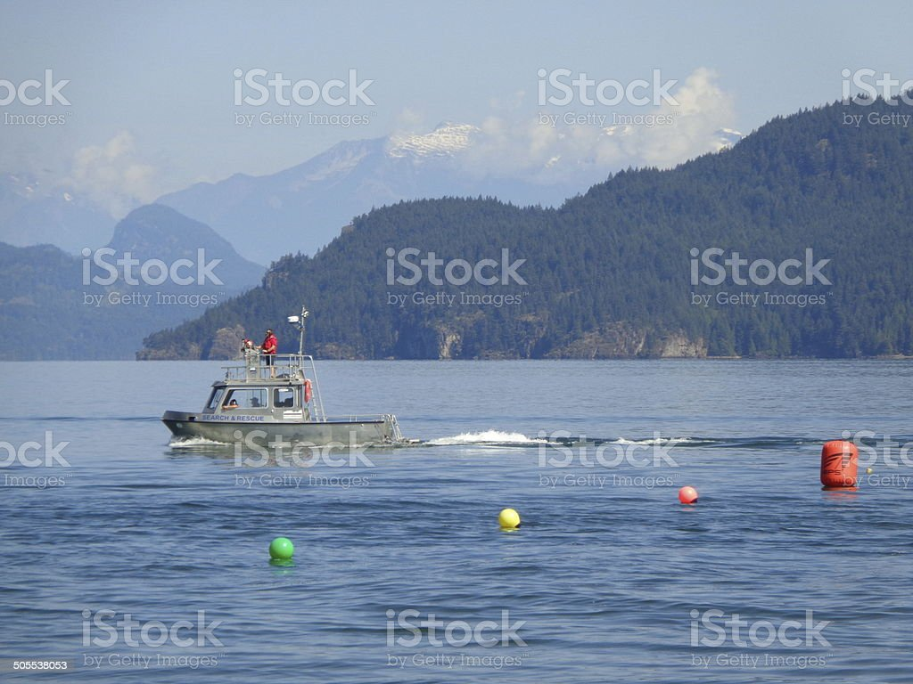 Tugboat and colorful buoys on B.C. Lake stock photo