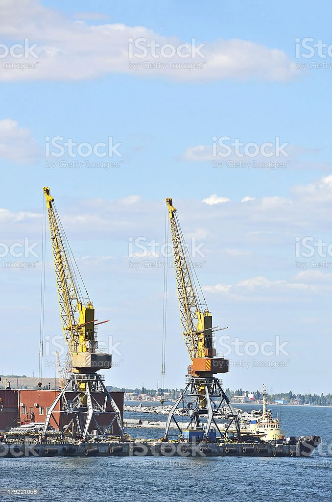 Tugboat and freight train under port crane royalty-free stock photo