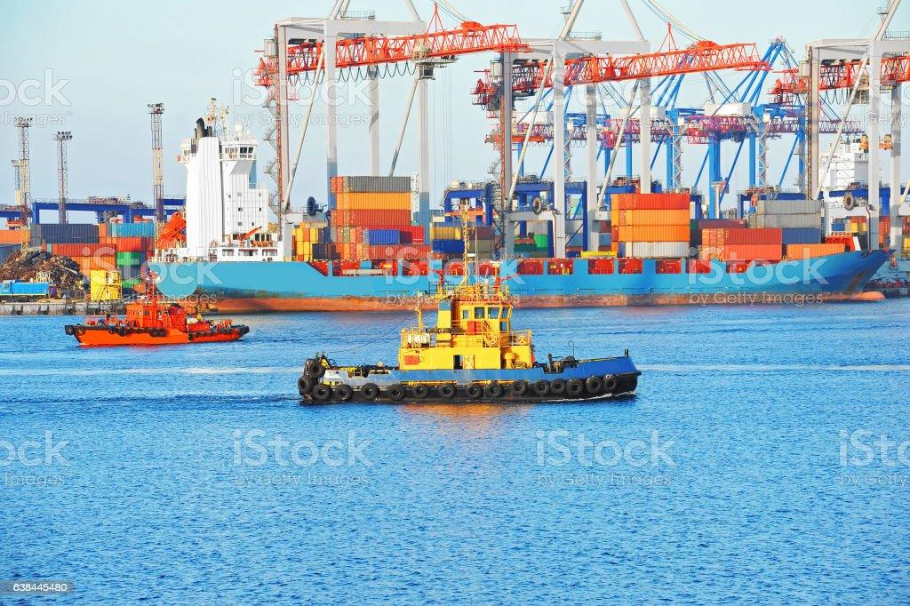 Tugboat and port cargo crane stock photo