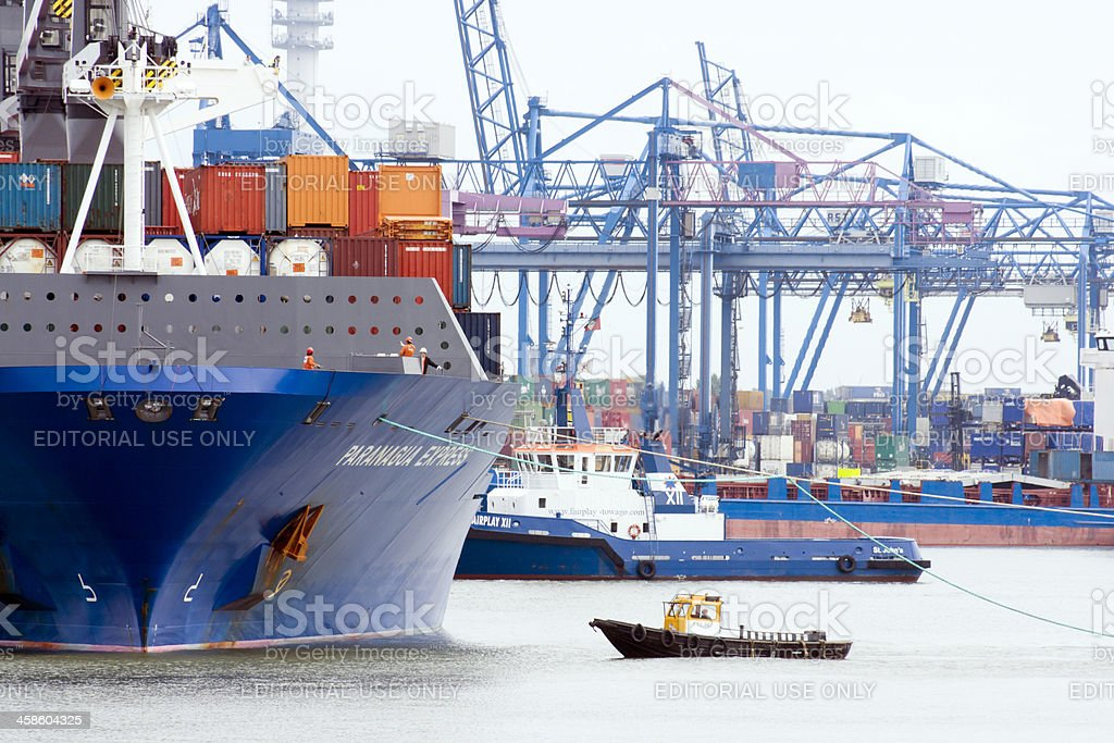 Tugboat at tanker in Rotterdam Harbor royalty-free stock photo