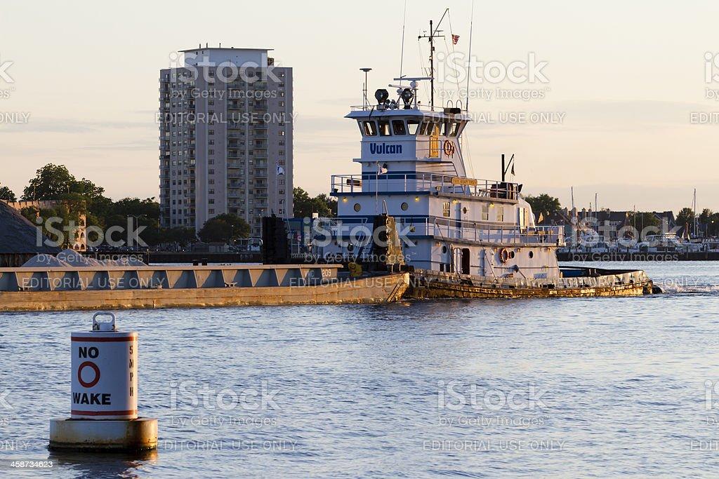 Tugboat Capt. Henry Knott with Barge on the Elizabeth River. stock photo