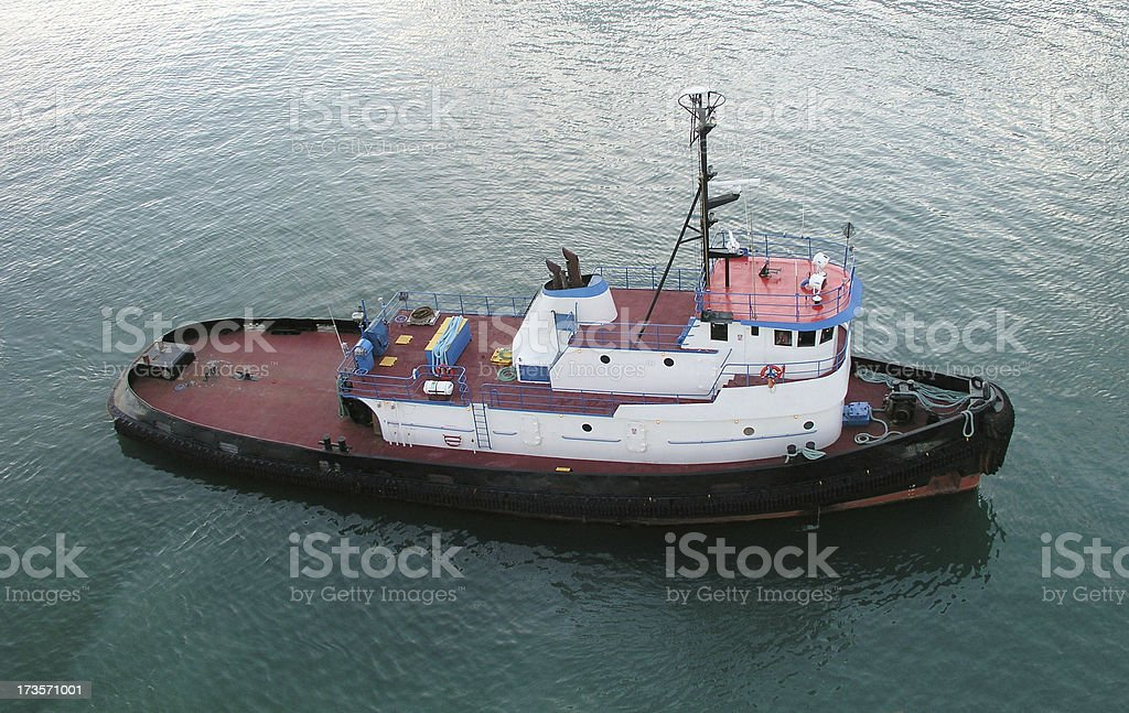 Tugboat going right stock photo
