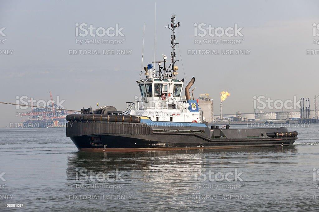tugboat in harbor stock photo