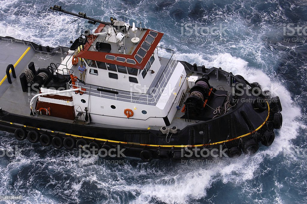 Tugboat in stormy seas - see portfolio for MORE royalty-free stock photo