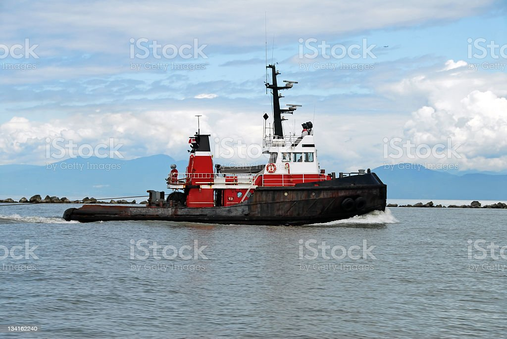 Tugboat near the harbour stock photo