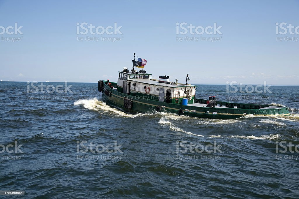 Tugboat on blue water royalty-free stock photo