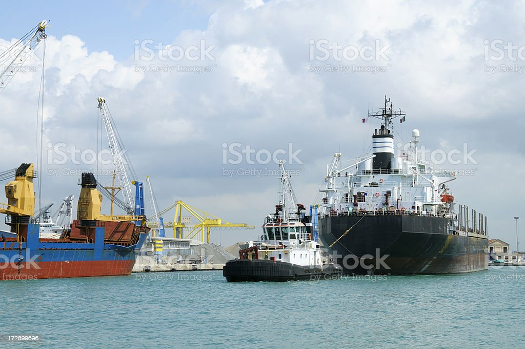 Tugboat pulling a cargoship royalty-free stock photo
