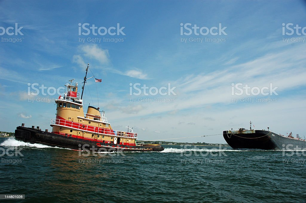 Tugboat Pulling Barge stock photo