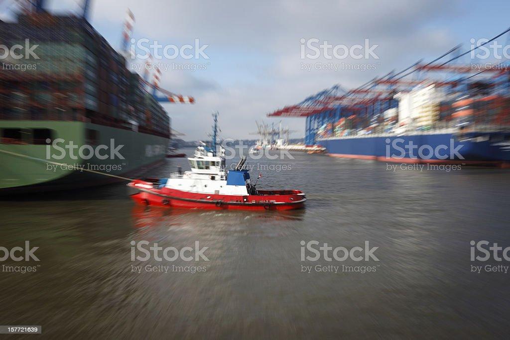 Tugboat Pulling Ship in Port of Hamburg royalty-free stock photo