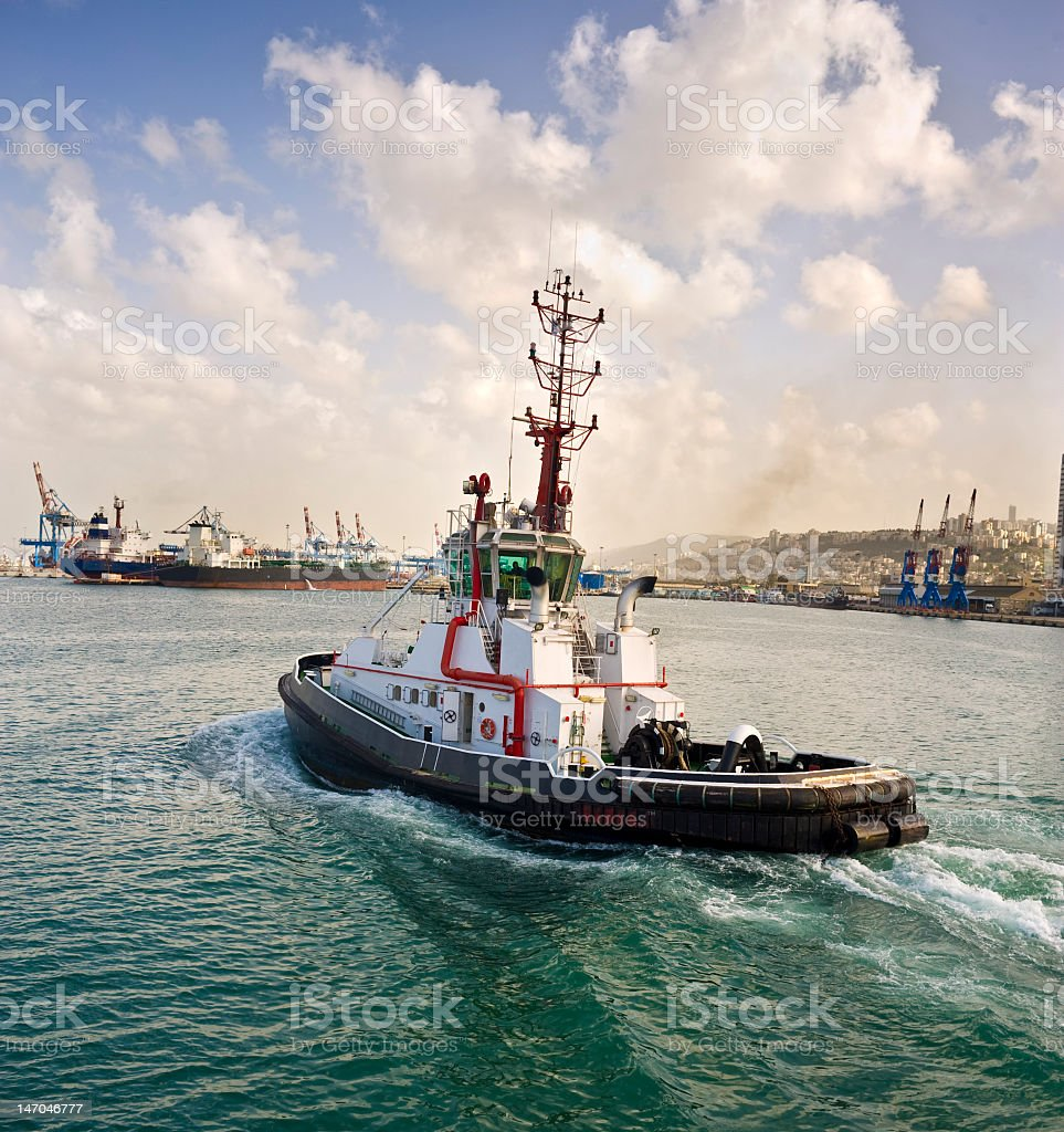 A tugboat sailing on the water stock photo