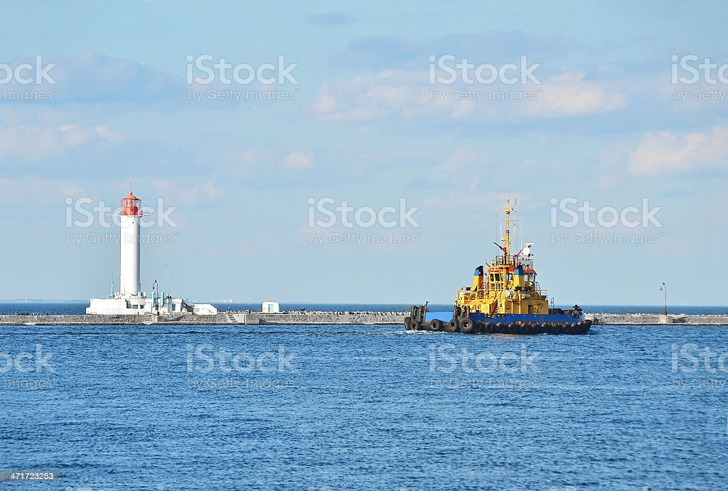 Tugboat ship and lighthouse royalty-free stock photo