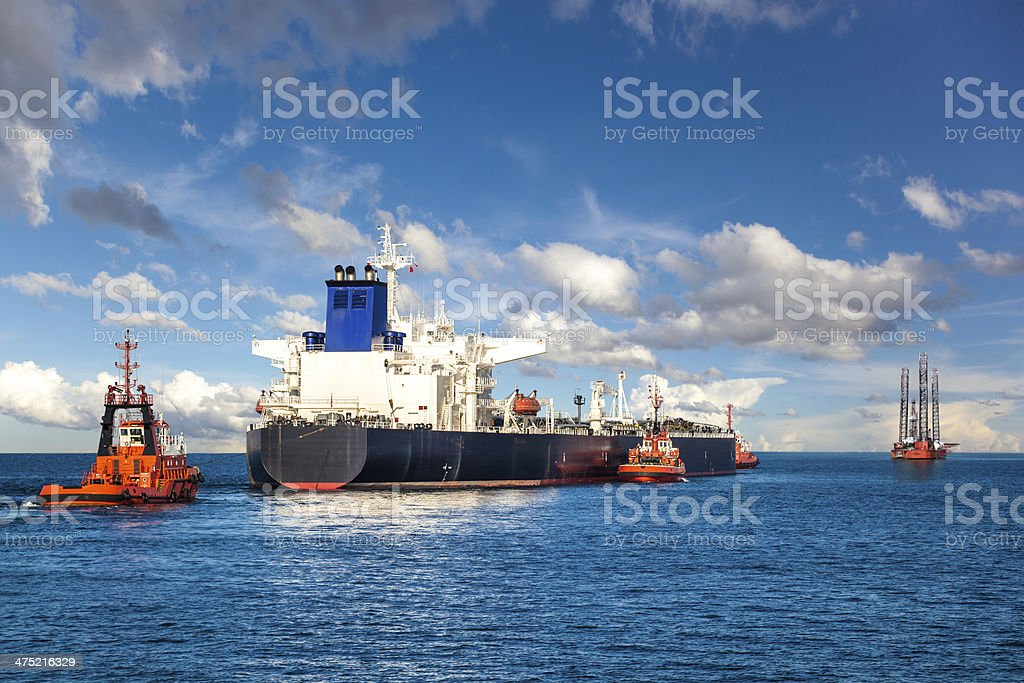 Tugboat towing a tanker stock photo