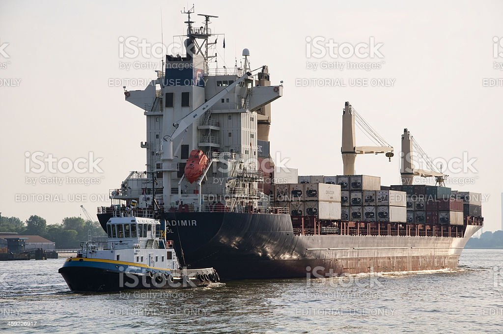 Tugboat towing container vessel royalty-free stock photo