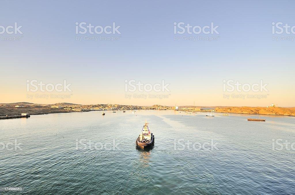 Tugboat Tuggging Into Luderitz stock photo