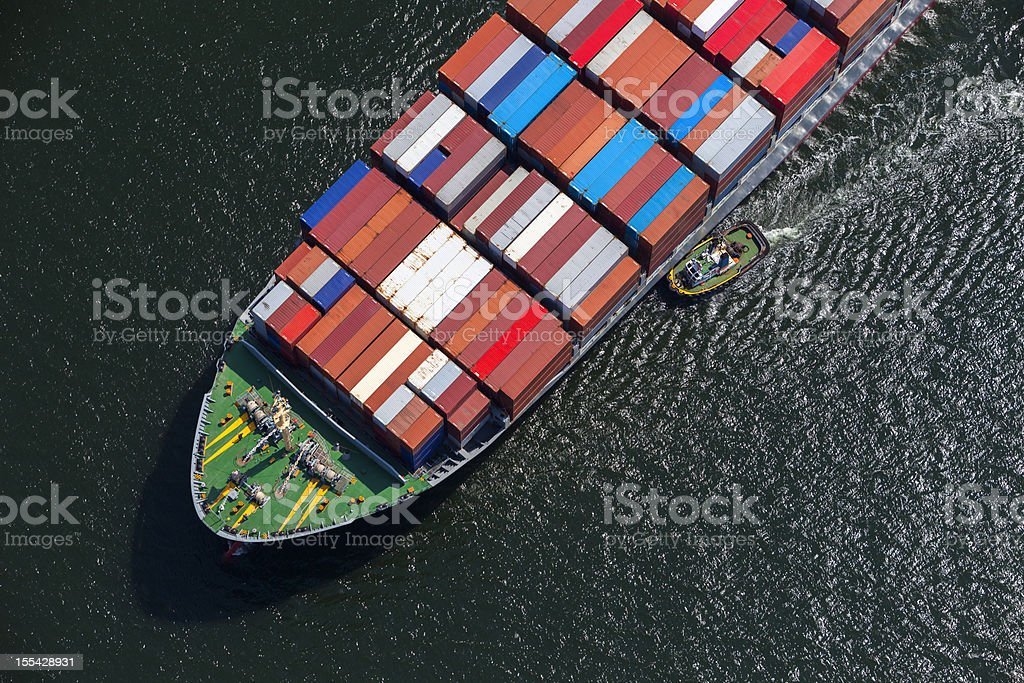 Tugboat vs. Ship stock photo