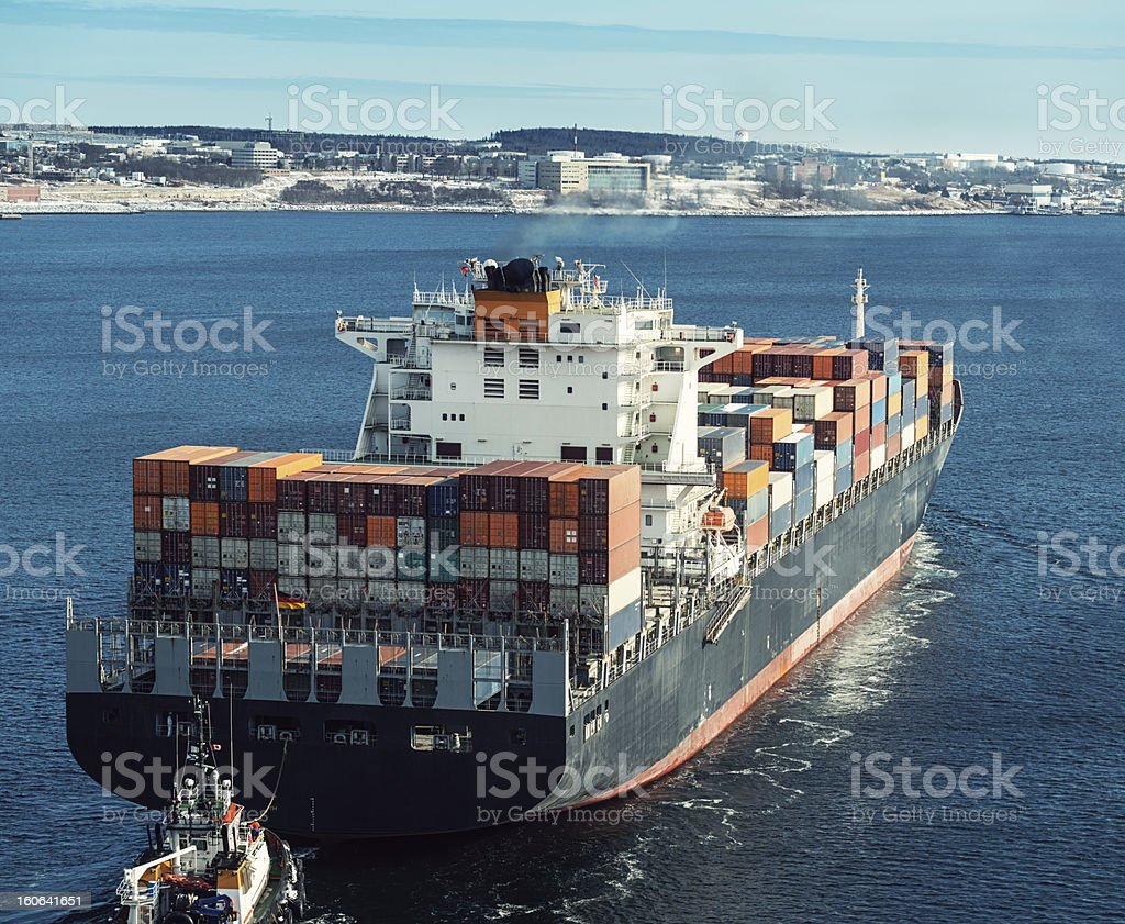 Tugboat with Container Ship royalty-free stock photo