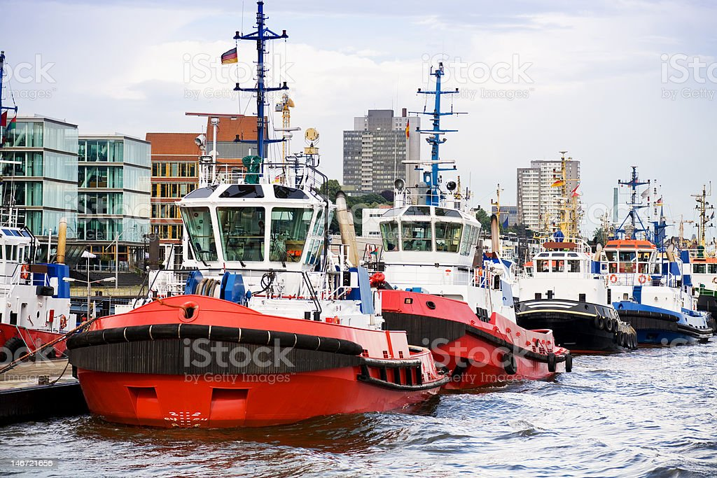 tugboats in a row royalty-free stock photo