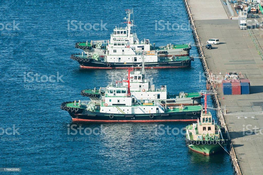 Tugboats moored at a port royalty-free stock photo