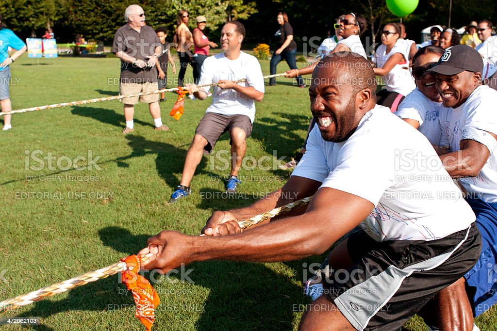 Tug-Of-War Teams Pull Rope In Summer Fundraising Event stock photo
