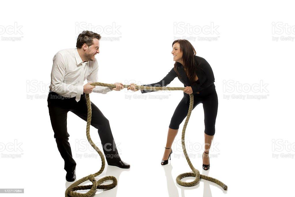 Tug-O-War between man and woman. royalty-free stock photo