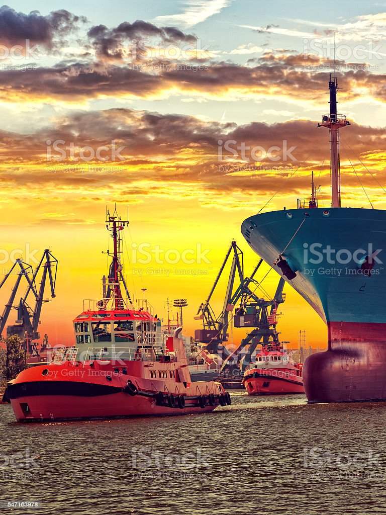 Tugs with ship stock photo