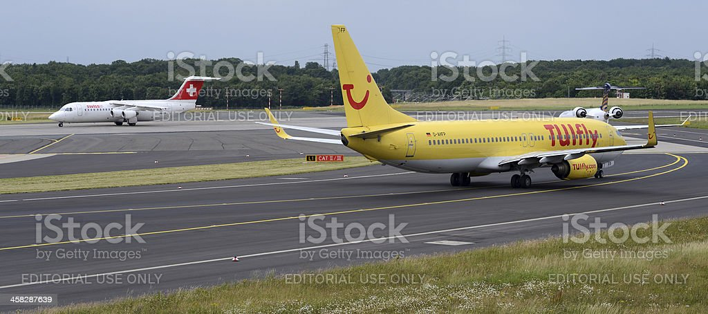 TUIfly, Eurowings, and Swiss Airplanes Lining Up for Takeoff stock photo