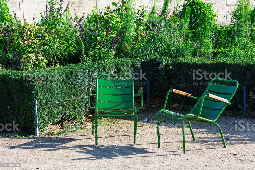 Tuileries Garden and two green garden chairs, Paris, France royalty-free stock photo