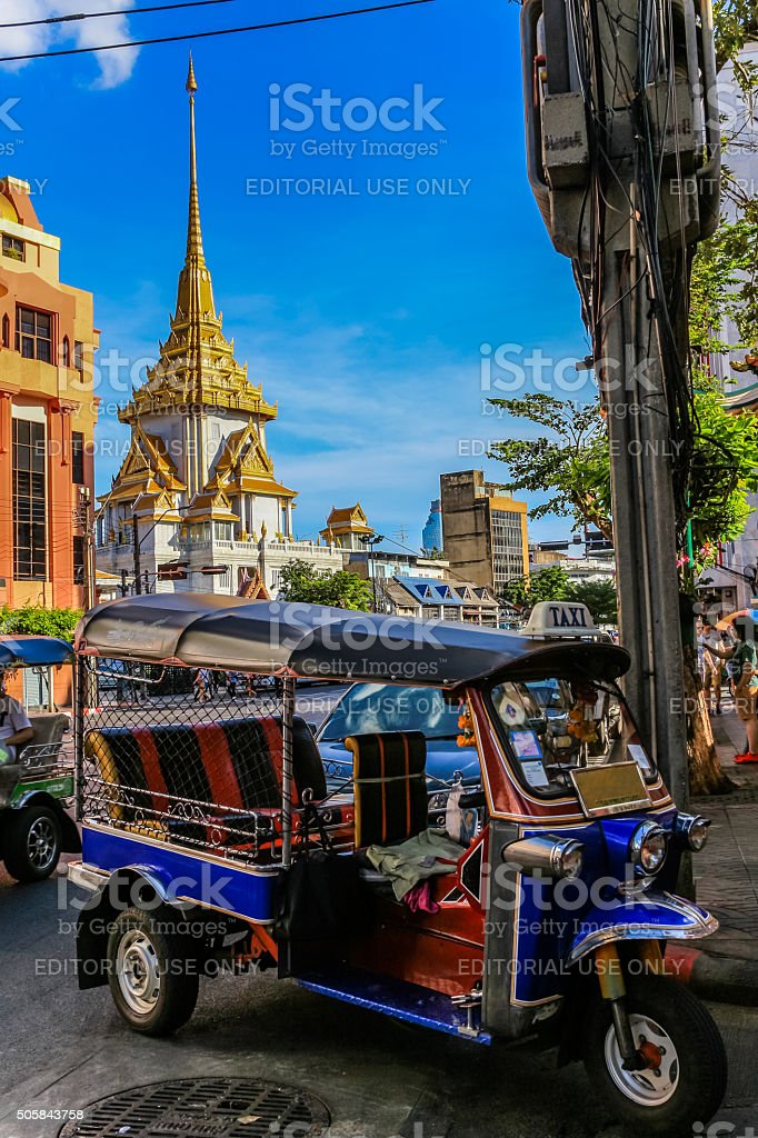 Tuk tuk and the Temple of the Golden Buddha, Chinatown, Bangkok. stock photo